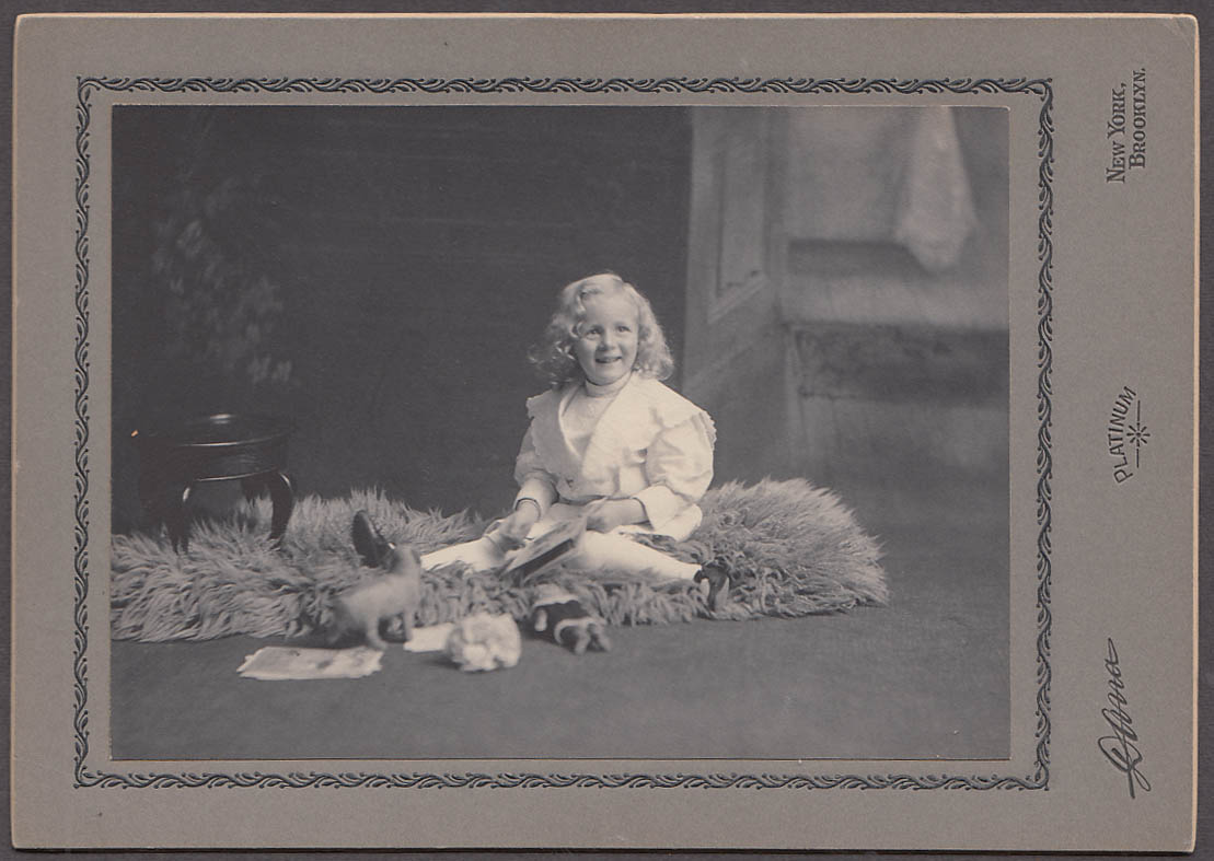Little blonde girl Bert plays amid toys photo by Dana Brooklyn NY ca 1905