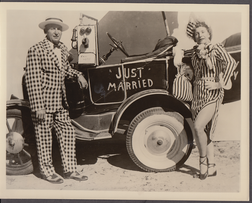 Older man & woman clown act with Just Married gag auto ca 1930s