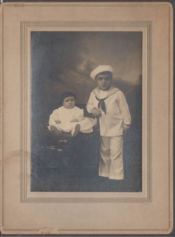 Boy in sailor suit with baby sibling studio photo ca 1910s