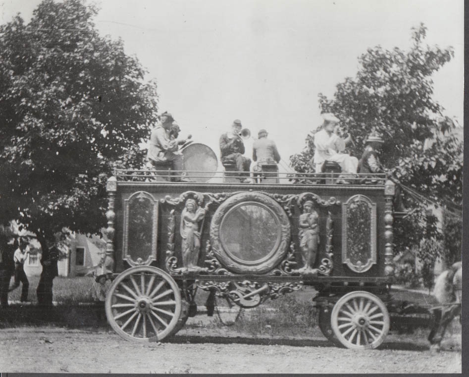 Circus figural-decorated wagon with band playing atop photo 1920s