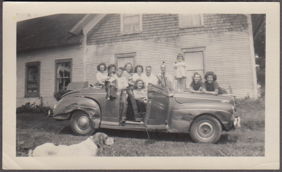 11 people & ventriloquist dummy on 1941 Mercury with dog vernacular photo