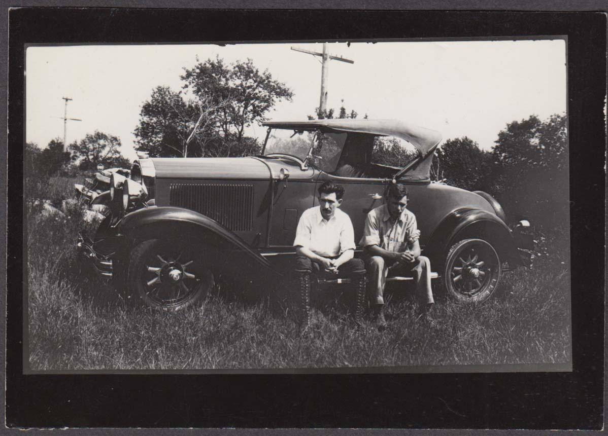 2 men sitting on the running board 1930 Buick roadster snapshot