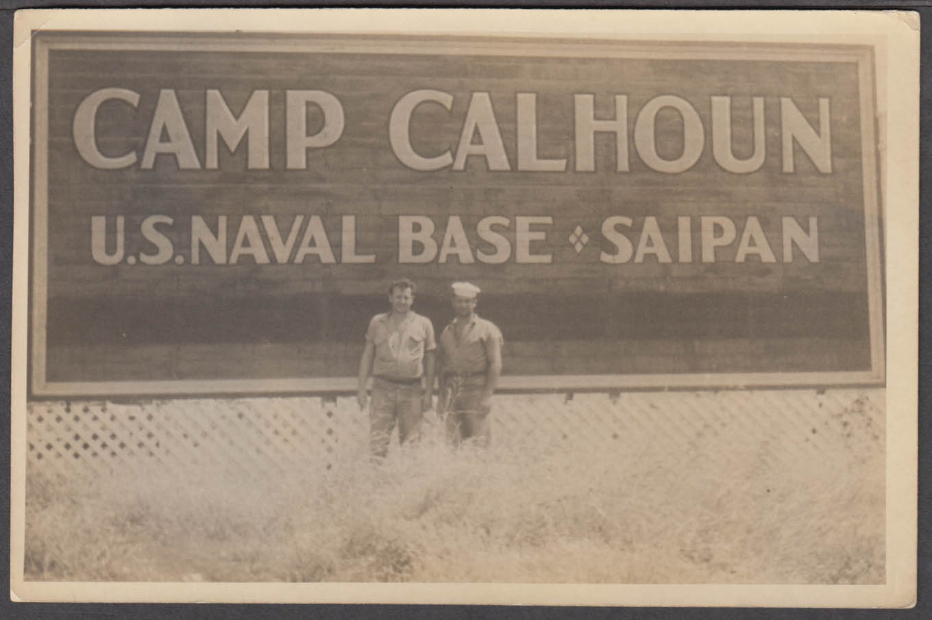 2 US Navy sailors in front of Camp Calhoun US Naval Base Saipan photo 1945