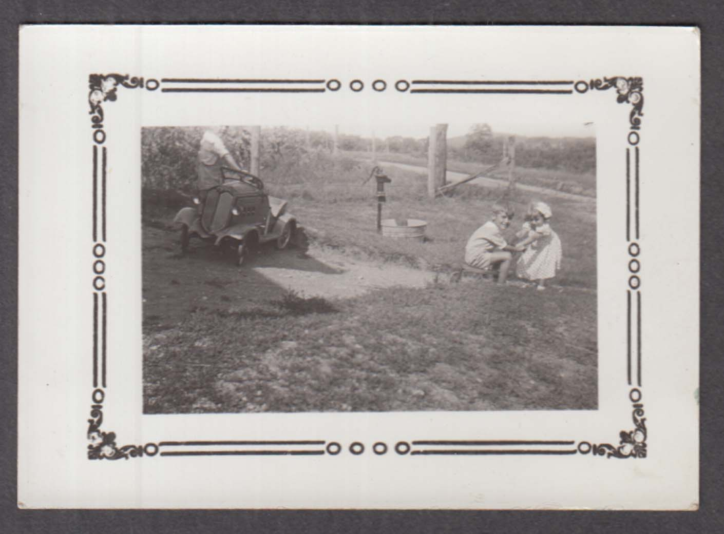 1930s Buick pedal car with Joan & Johnnie Jr playing photo 1935