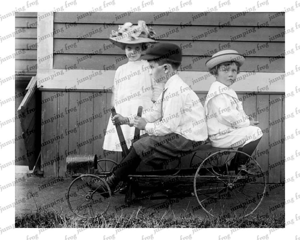 3 kids 3 hats 2 on lever-driven go cart 8x10 ca 1890s