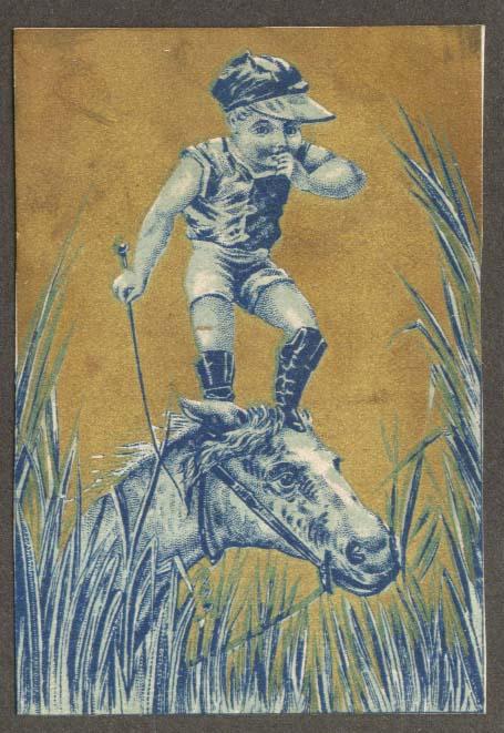 Boy jockey stands on horse's head trade card