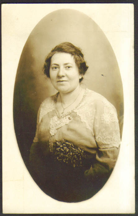Round-faced woman lace-trim dress RPPC postcard Stoddard 1910s