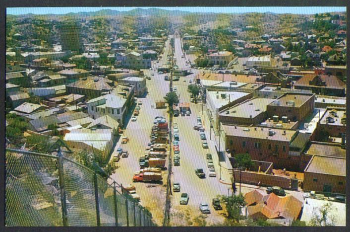 Nogales Sonora MX Nogales AZ Fence Line postcard 1950s