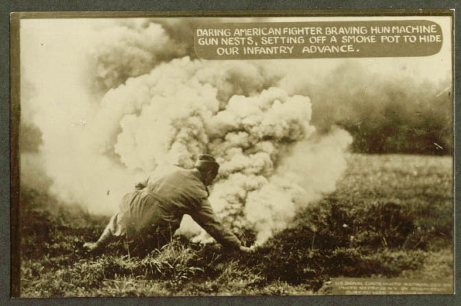 Setting smoke pot to hide US infantry charge RPPC 1918