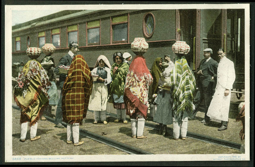 Navajo Pueblo Indians sell pottery train passengers Albuquerque postcard 1900s