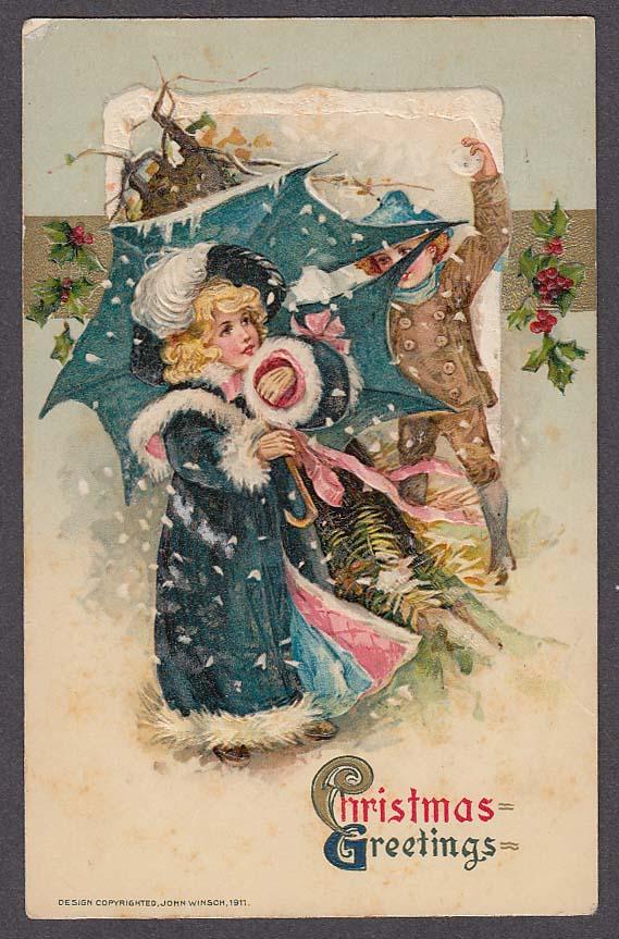 Christmas Greetings boy throwing snowball at girl embossed postcard 1911