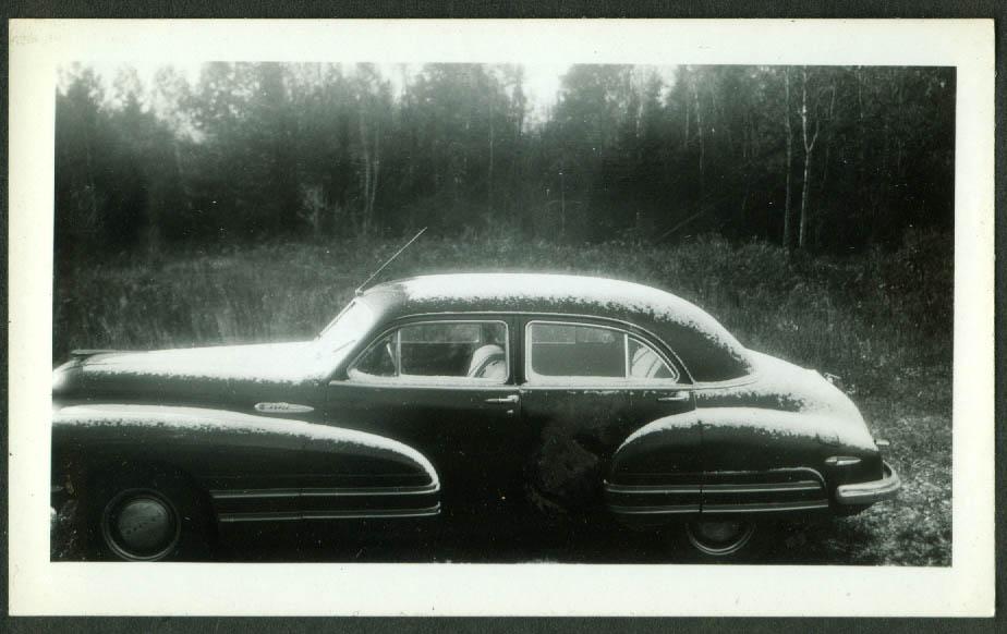 1942 Buick Super 4-door sedan lightly snowed upon snapshot