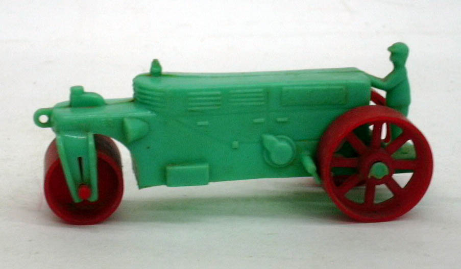 "Banner green plastic steamroller red wheels 1950s 3 3/4"" long."