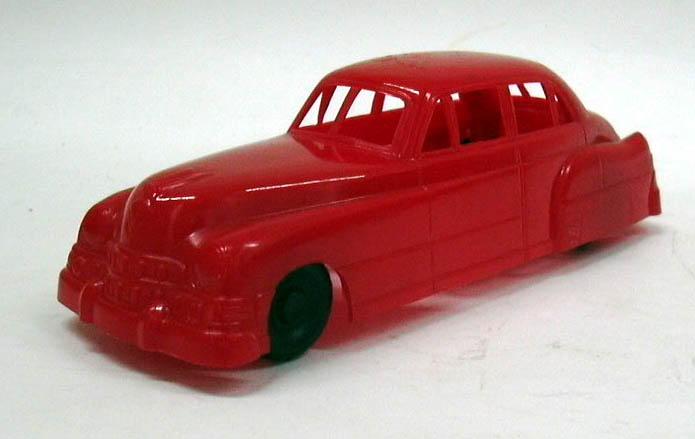 """Lapin 1949 Cadillac Sedan 6"""" long red plastic car"""