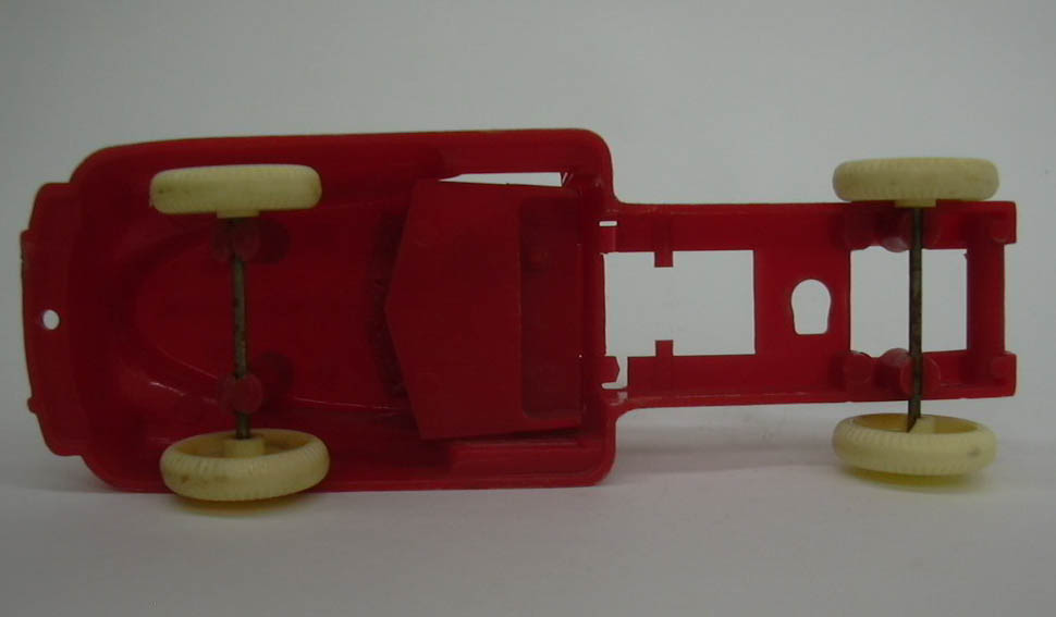Renwal red plastic truck, no trailer, missing a door; for parts 1950s